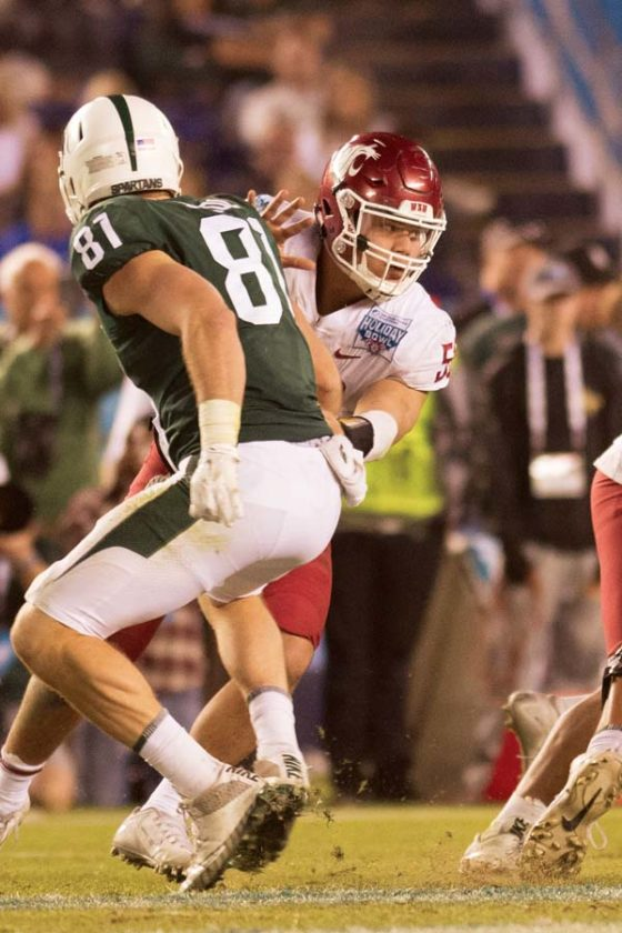 Washington State's Hercules Mataafa gets past a Michigan State player in the Holiday Bowl. -- JAKE RYAN photo