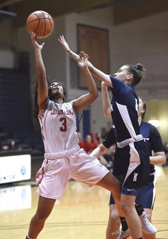 Lahainaluna's Rachael Balagso drives for a second-quarter shot as Kamehameha Maui's Kealia Sjostrand defends. -- The Maui News / MATTHEW THAYER photo
