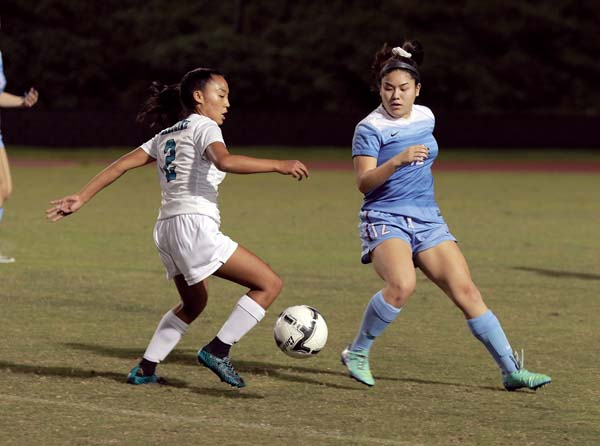 King Kekaulike High School's Teani Arakawa dribbles in front of Baldwin's Bailey Keator during the first half of the Bears' 2-1 win over Na Alii on Saturday at War Memorial Stadium. - The Maui News / CHRIS SUGIDONO photo