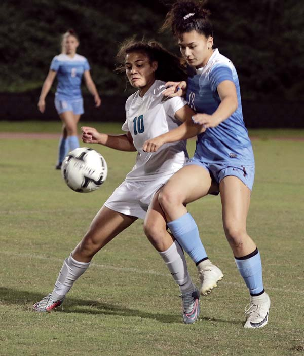 Baldwin's Darcy Catan and King Kekaulike's Angelle Ferge battle for a ball in the first half. - The Maui News / CHRIS SUGIDONO photo