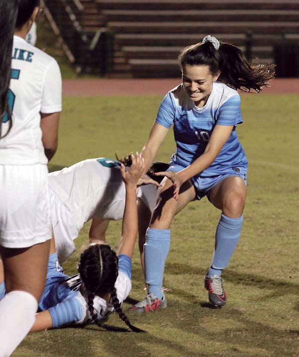 Ferge congratulates Kassie Inouye after Inouye scored a first-half goal. - The Maui News / CHRIS SUGIDONO photo