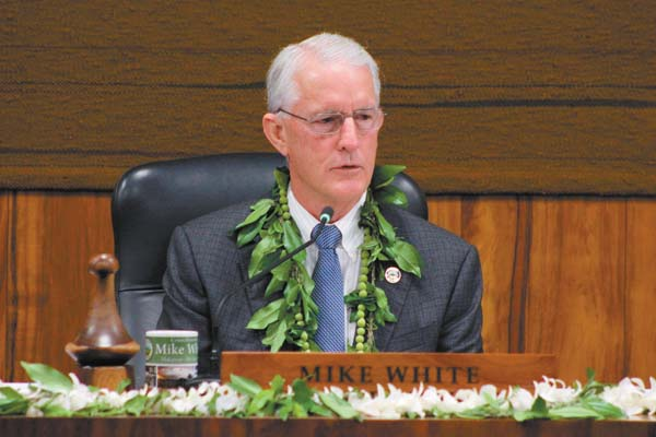 Mike White presides over the Maui County Council shortly after being re-elected as chairman in January. The meeting lasted from 2 p.m. Jan. 2 to around 3:30 a.m. Jan. 3 as council members listened to five hours of public testimony and worked to iron out leadership and staffing issues. The Maui News / COLLEEN UECHI photo