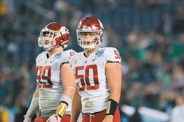 In his junior season, Hercules Mataafa (No. 50) tallied 22.5 tackles for loss and 10.5 sacks for Washington State. JAKE RYAN photo