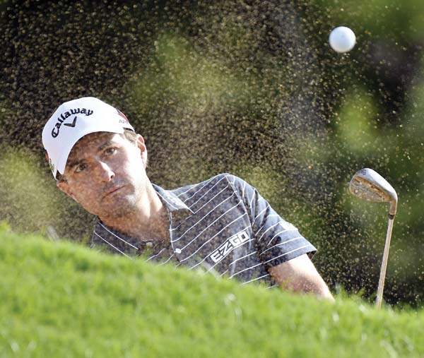 Kevin Kisner blasts from a practice bunker at the Kapalua Plantation Course on Tuesday morning.