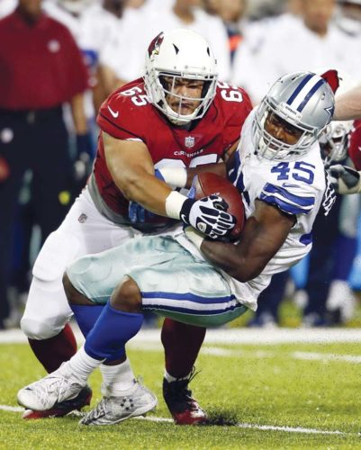 Pasoni Tasini of the Arizona Cardinals tackles the Dallas Cowboys' Rod Smith during a preseason game in August. AP file photo