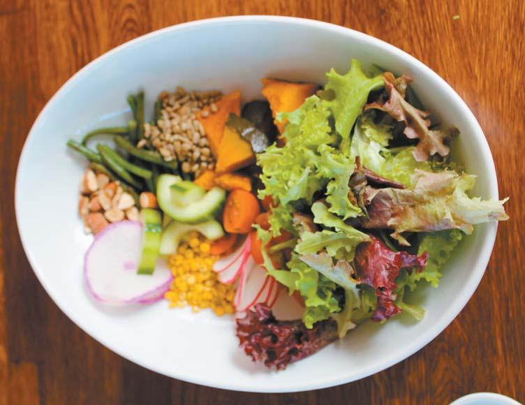 Hoaloha salad mixes Waipoli greens, kabocha pumpkin, tomato, cukes, split peas, almonds and long beans.