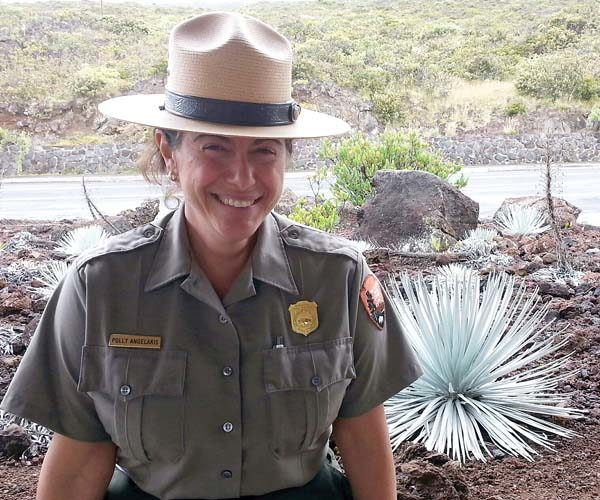 Chief of Interpretation and Education Polly Angelakis stands by an endangered silversword. -- National Park Service photo