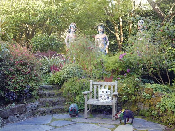 """Viola Frey's """"The Three Graces"""" in the Rena Bransten Garden, a private residential garden in San Francisco. It's featured in the book """"Private Gardens of the Bay Area"""" by Monacelli Press. -- AP photo"""
