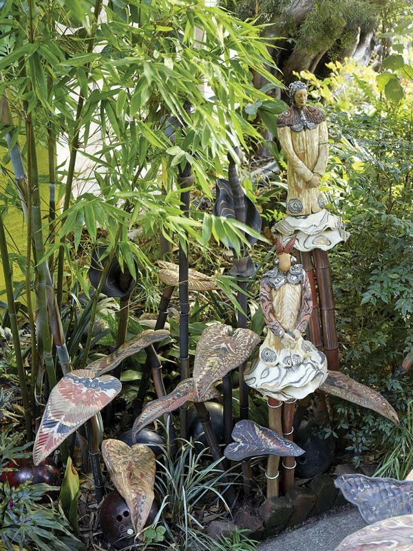 """Sprites and colorful leaf-shapes atop bamboo-like stems are interspersed with the plants in the Marcia Donahue Garden in Berkeley, Calif. The garden is featured in the book """"Private Gardens of the Bay Area."""" -- AP photo"""