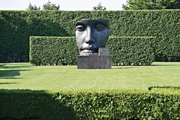 """""""Per Adriano"""" by sculptor Igor Mitoraj in a residential estate on the east end of Long Island in New York. It was designed by landscape architect Edmund Hollander.  -- AP photo"""