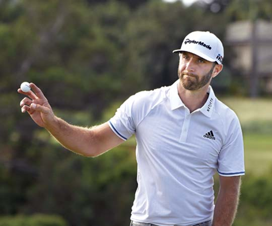 Dustin Johnson acknowledges the gallery at the Kapalua Plantation Course's ninth hole after making a birdie during the third round of the Sentry Tournament of Champions on Saturday. - The Maui News / MATTHEW THAYER photo