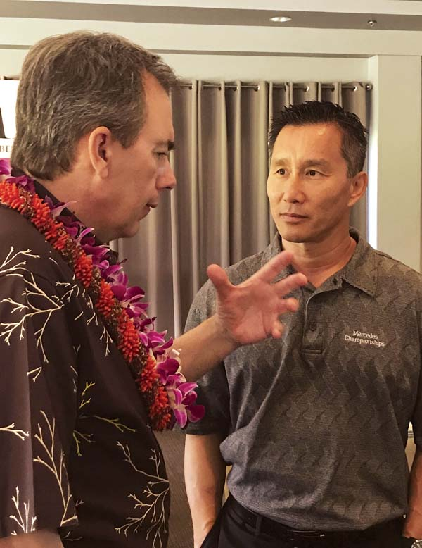 Mark Dunkerley, president and chief executive officer of Hawaiian Airlines, talks to Maui business owner Max Tsai of TC Kokua on Monday following a Maui Chamber of Commerce annual Hawaiian Airlines luncheon at Cafe O Lei at the Dunes at Maui Lani. The Maui News / MELISSA TANJI photo