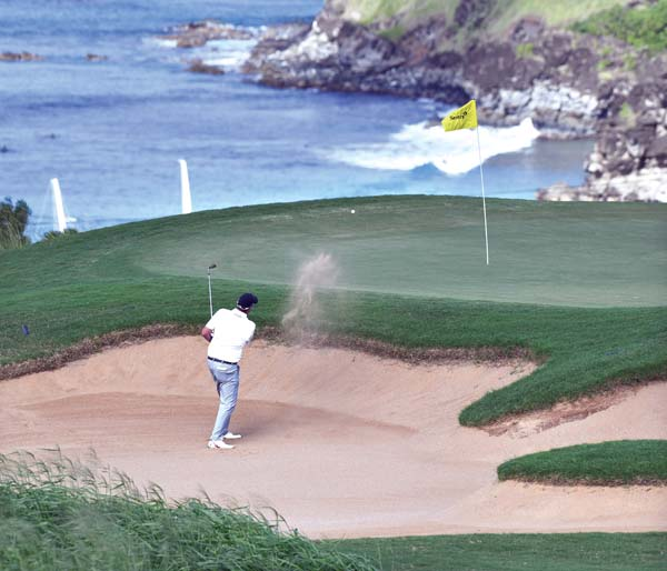 Marc Leishman hits out of a sand trap on the picturesque No. 11 Saturday at the Sentry Tournament of Champions at the Kapalua Plantation Course. The five-year sponsorship deal by Sentury Insurance has removed the uncertainty hanging over the tournament and its run at Kapalua, PGA officials said. The Maui News / MATTHEW THAYER photos