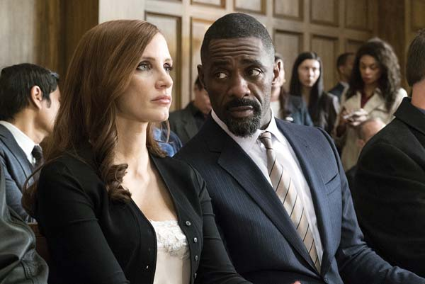 "Jessica Chastain (left) and Idris Elba star in ""Molly's Game."" STXfilms via AP"