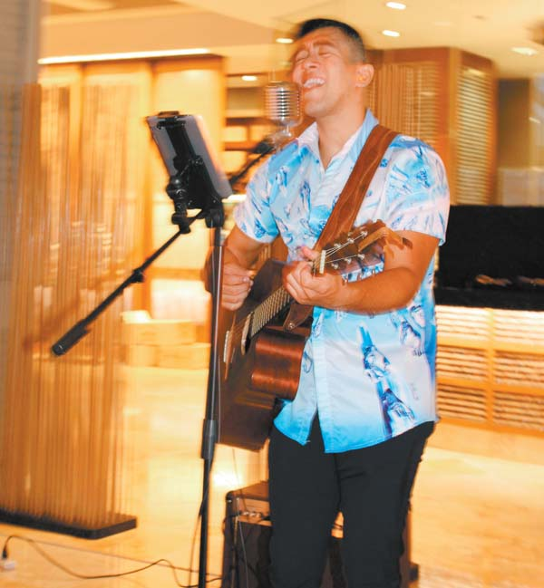Soloist Brian Santana plays during dinner Fridays at DUO Steak & Seafood in the Four Seasons Resort Maui. The Maui News / CARLA TRACY photo