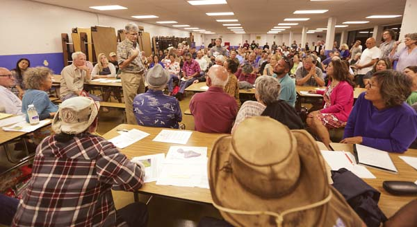 Robert Whittier, hydrogeologist with the Health Department's Safe Drinking Water Branch, speaks to about 250 Upcountry residents about cesspools Tuesday night at the Mayor Eddie Tam Memorial Center in Makawao. The Maui News / CHRIS SUGIDONO photos