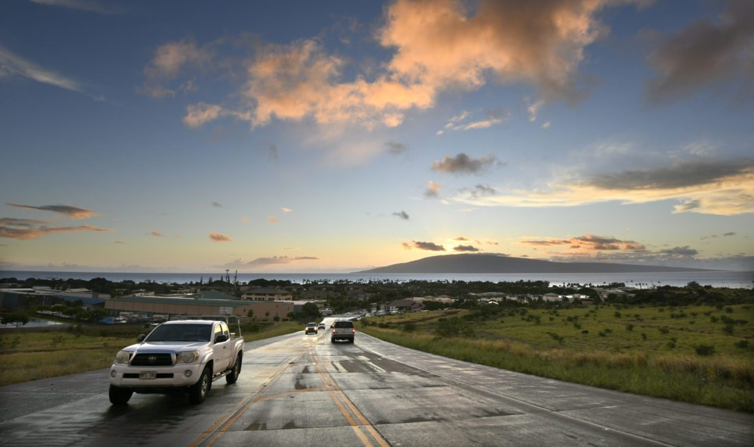 Motorists make their way up and down the northern portion of the Lahaina bypass last month as the sun sets over the island of Lanai. This bypass segment is mauka of the Lahaina Gateway and the intersection of Keawe Street and Honoapiilani Highway.  • The Maui News / MATTHEW THAYER photo