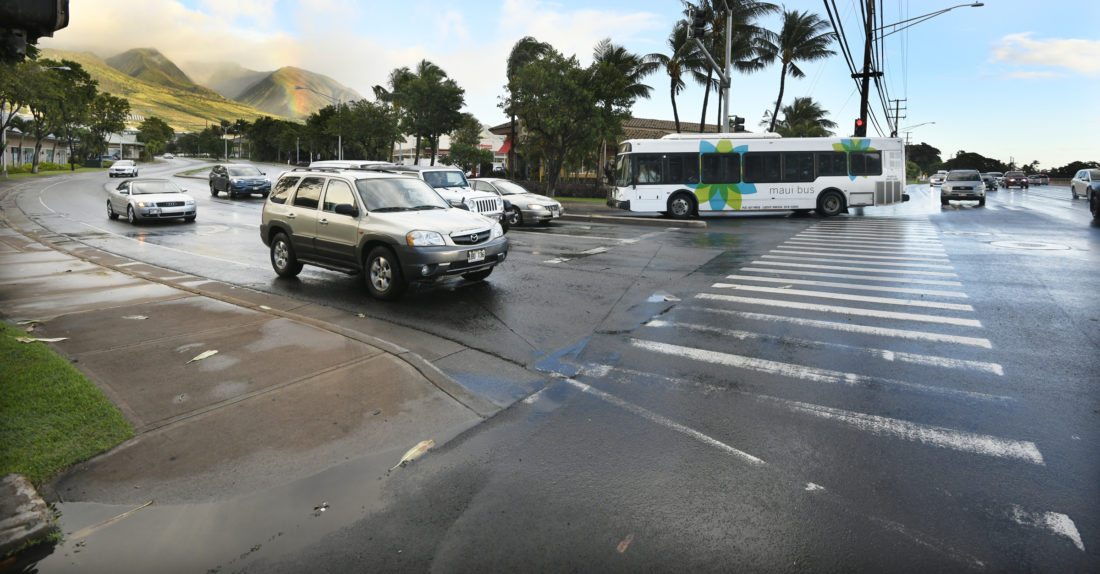 A Maui Bus turns off Honoapiilani Highway and onto Keawe Street in Lahaina last month. Some residents and business operators are concerned about increased traffic congestion at the highway's Keawe Street intersection, where improvements are planned. • The Maui News / MATTHEW THAYER photo