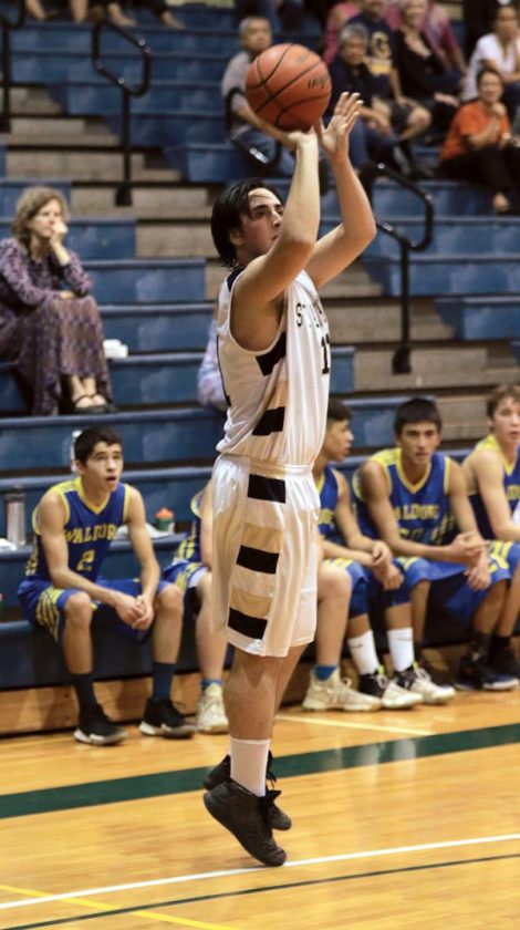Luke Jones of St. Anthony shoots a 3-pointer in the first quarter.  - The Maui News / CHRIS SUGIDONO photo