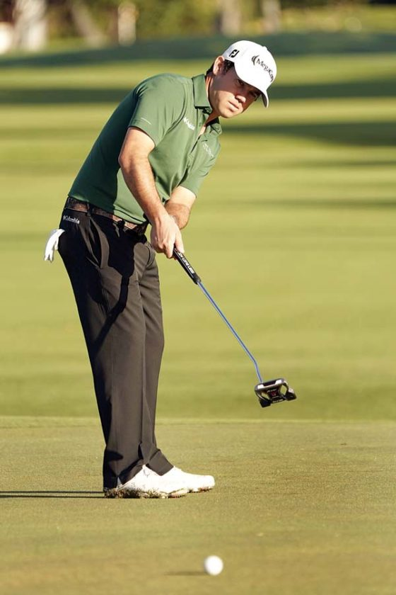 Brian Harman putts on the 13th green during the second round of the Sony Open on Friday. -- AP photo