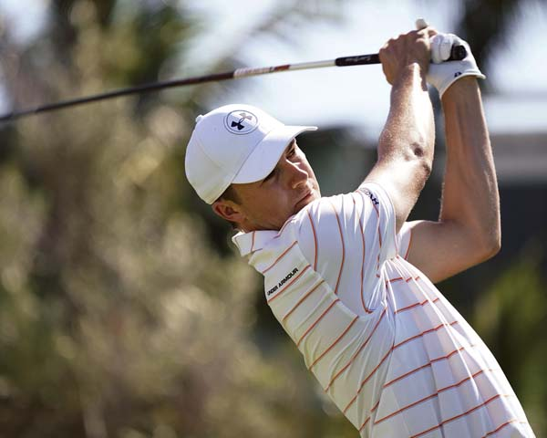 Jordan Spieth watches his shot from the first tee during the second round Friday. -- AP photo