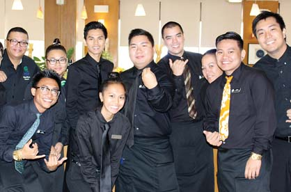 Dining Room Lecturer Marc Malone (at far left) with students -- The Maui News / CARLA TRACY photo