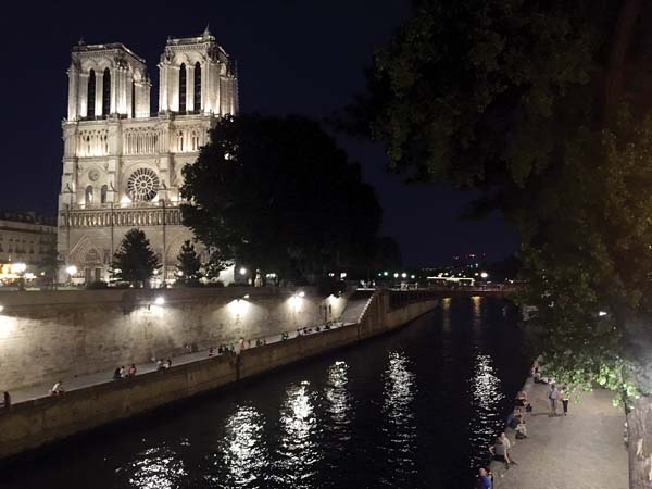 Notre Dame Cathedral, illuminated at night, was the setting of two novels by author Richard Wright. -- AP photo