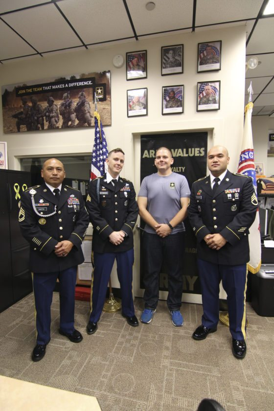 Sgt. 1st Class Jesse Santos (from left), Sgt. John Miltenberger, Army recruit Jimmie Rogers and Staff Sgt. Luke Failauga pose in the U.S. Army Recruiting Center in the Queen Ka'ahumanu Center on Sunday. Santos instituted a thrice-weekly workout program for hopeful recruits trying to make weight and body-fat standards. Rogers lost more than 100 pounds after joining the program to support his roommate, Lutoviko Taai.  • The Maui News / COLLEEN UECHI photo