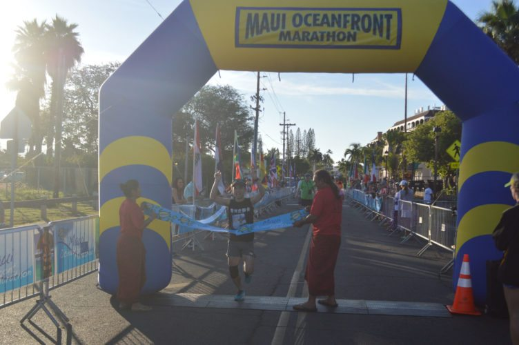 Tadashi Yamaura of Vancouver, B.C., crosses the finish line on Front Street to win the Maui Oceanfront Marathon on Sunday. • The Maui News / ROBERT COLLIAS photo