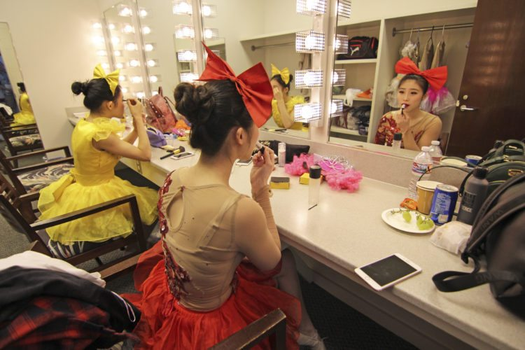Dancers Chi Chi (right) and An An of the Anhui Acrobatic Troupe apply makeup backstage Monday afternoon before their performance at the Maui Arts & Cultural Center. The Acrobats of China featuring the New Shanghai Circus opened with two shows Monday and will perform again at 4 and 7 p.m. today in the Castle Theater. • The Maui News / COLLEEN UECHI photo