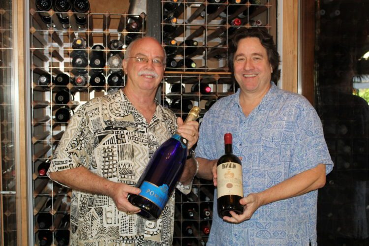 General Manager Michael Rose (left) and Owner Peter Longhi are proud of their repeat Best Award of Excellence wine list from the Wine Spectator magazine. They stand in Longhi's Wailea wine cellar, which holds 500 bottles ranging from $28 to $1,000. • The Maui News / CARLA TRACY photo