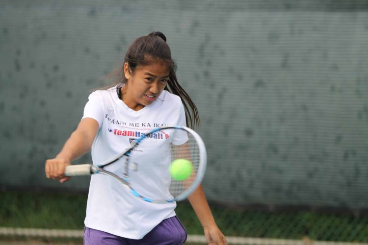 Nikki Fernando of Kihei competes during the Wailuku Winter Junior Sectionals last weekend. Fernando, 13, won the girls 18 singles division, defeating Tayvia Yamagata of the Big Island 7-5, 3-6, 6-4 in the final. • MANNY FERNANDO photo