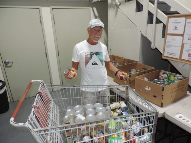 "Kihei resident Jim Sheppard is a regular volunteer at the Maui Food Bank, where he sorts cans, stocks shelves and assembles bags of food — and always with a smile on his face. ""It's a pleasure and a privilege to be here,"" he said."