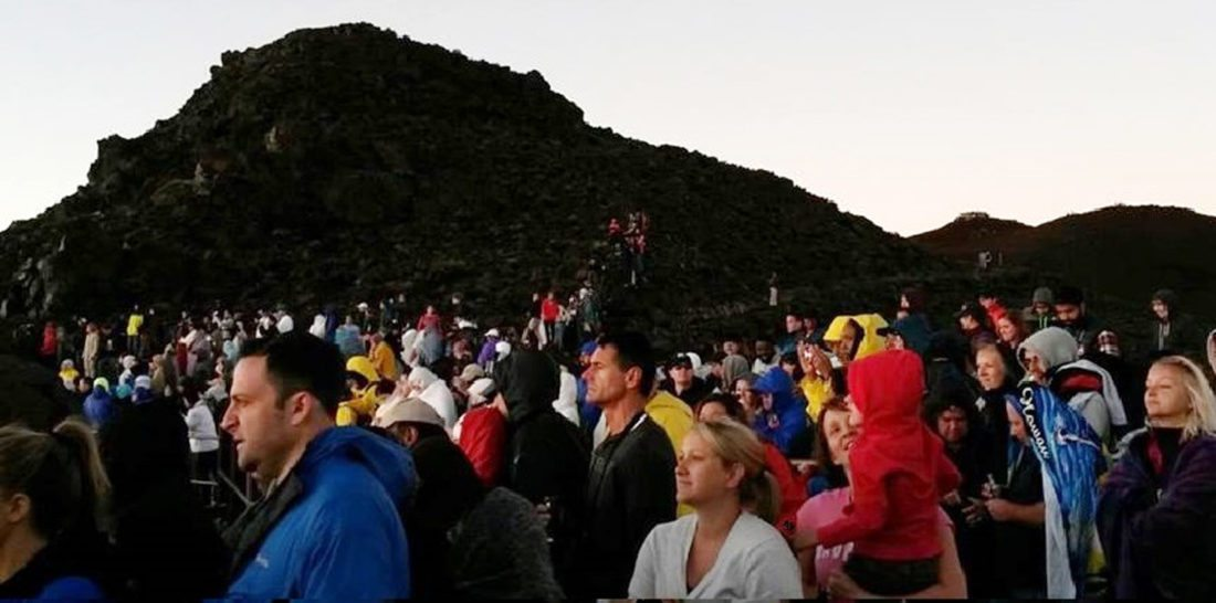 Visitors watch the sunrise from the Haleakala National Park summit in 2015. Park officials are working to modify a Haleakala sunrise reservation program in the future to allow for cancellations and a waitlist. • Photo courtesy Haleakala National Park