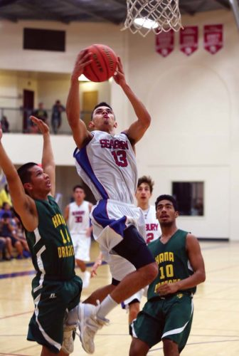 Seabury Hall's Isaiah Payne goes up for a layup in front of Hana's Keoki Hoopai-Waikoloa (left) and Nahinu Lind in the second quarter of the Spartans' 65-19 win Friday at Erdman Athletic Center. - The Maui News / CHRIS SUGIDONO photo