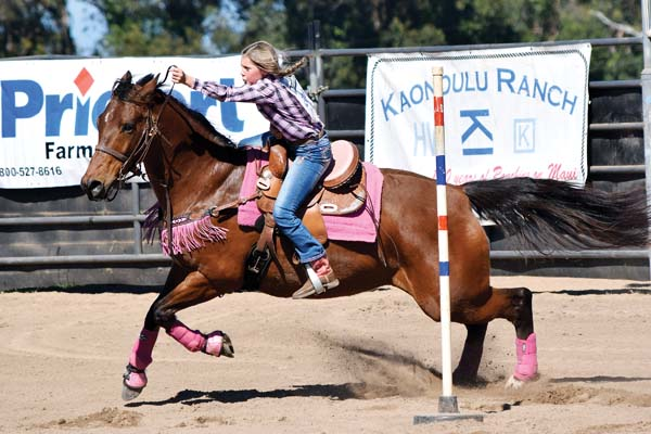 Emily Coflin heads to a first-place finish in junior pole bending during the Hawaii High School Rodeo Association Junior/High School Show No. 8 on Sunday at Kaonoulu Ranch. -- EMY FERGUSON photo