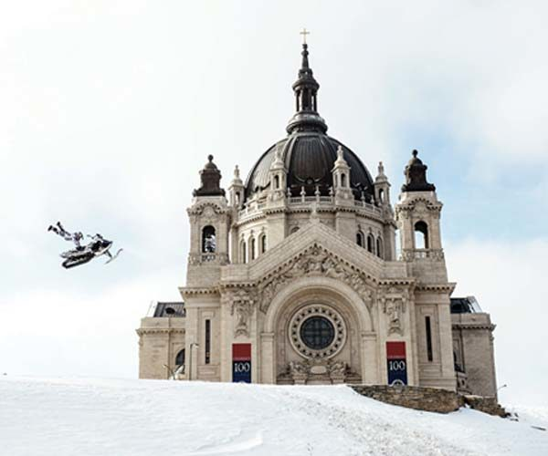 A snowmobile stunt near the Cathedral of St. Paul in St. Paul, Minn. -- AP photo