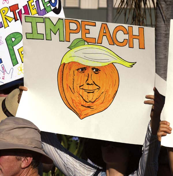 Some colorful signs promote messages of love and understanding Saturday, while others took aim at President Donald Trump. - The Maui News / MATTHEW THAYER photo