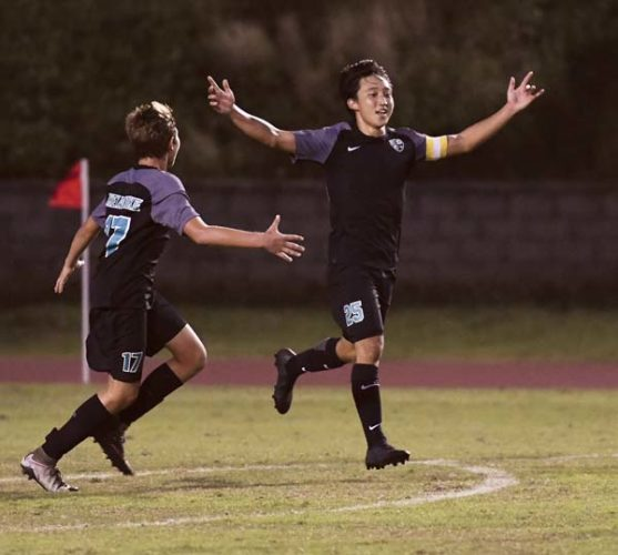 King Kekaulike High School's Cade Taniguchi celebrates his goal as teammate Finn Bediamol joins him during the second half of Na Alii's 3-1 win over Baldwin on Saturday night at War Memorial Stadium. - The Maui News / MATTHEW THAYER photo