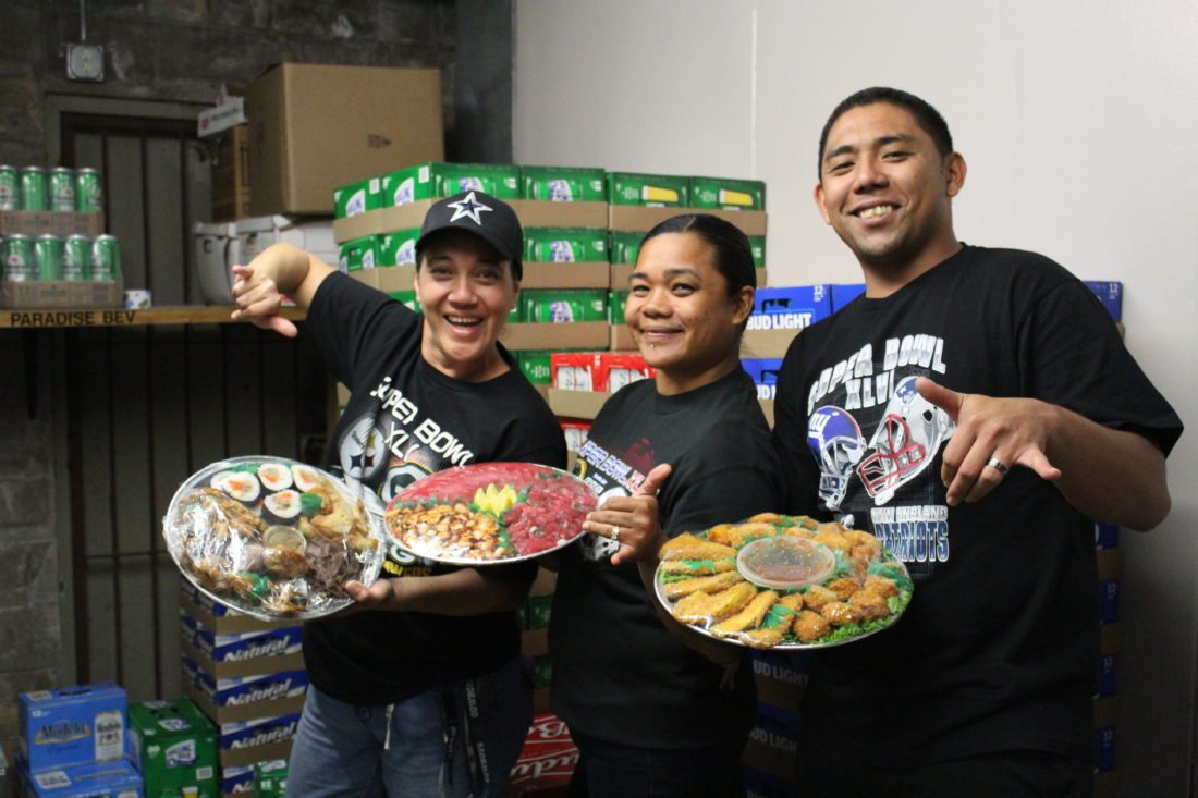 Takamiya Market's Randan Tamashiro (from left), Pua Rapisurra and Paula Namahoe parade their platters available to order for take out. • The Maui News / CARLA TRACY photo