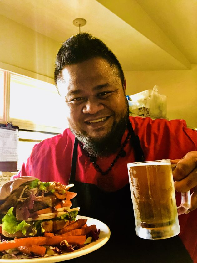 Stopwatch Sports Bar & Grill Chef Ola Miner shows off his Paniolo Burger with Maui Cattle Co. beef, crisp onions, Swiss cheese and barbecue sauce with sweet potato fries and a Big Swell draft. • Photo courtesy Stopwatch