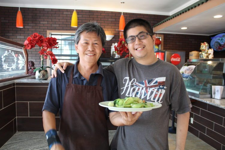 New Wei Wei Cafe & Noodle House in Happy Valley is owned by Chef Shao Xiao (left) and the front of the house is run by his son Adam Xiao. The small walkup counter establishment is as neat as a pin with authentic  Chinese cuisine.   • CARLA TRACY photo