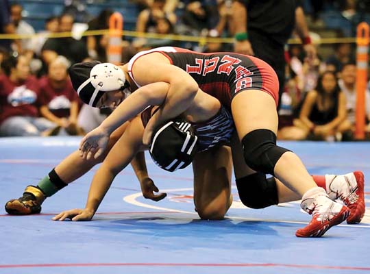Lahainaluna High School's Nanea Estrella takes on cousin Waipuilani Estrella-Beauchamp of Baldwin earlier this season. Estrella is the top seed at 122 pounds and Estrella-Beauchamp is No. 1 at 127 for today's MIL championships at Lahaina Civic Center. --JASON HAYASE photo