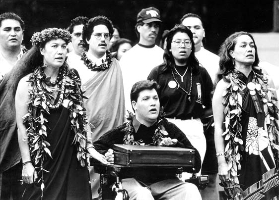 Kanalu Young (center) was in       the front line of the 1993 'Onipa'a march, which          observed the 100th        anniversary of the      Hawaiian Kingdom overthrow. -- Photo courtesy MACC