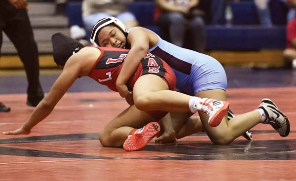 Baldwin High School's Jahnea Miguel works toward a second-period pin of Lahainaluna's Tayler Pelegrino-Hayase to win the girls 147-pound title at the MIL championships Saturday at Lahaina Civic Center. -- The Maui News / MATTHEW THAYER photo