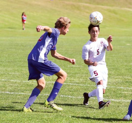 Jayden Kozaki of Baldwin High School and Seabury Hall's Shion Ward go for a ball in the first half of the Bears' 6-1 victory over the Spartans on Saturday. -- The Maui News / CHRIS SUGIDONO photo