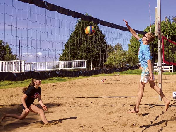 Tyler Russell spikes a ball toward Aina Frazier in Aloha Volleyball's season-ending 14s and under tournament Saturday in Kula. Russell and Ross Peck won the event — Russell has won the last four tournaments. -- SCOTTIE ZUCCO photo
