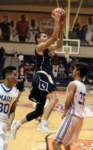 Kamehameha Schools Maui's Kamalu Segundo shoots over Maui High's Kea Aguirre while Keoki Agtaguem looks on in the second quarter of an MIL semifinal game Monday at Lahaina Civic Center. • The Maui News / CHRIS SUGIDONO photo