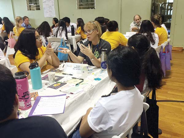 "Alexis Dascoulias, past president of the Rotary Club of Kahului, answers questions from campers at the ""Leaders Speed Dating"" segment of Camp RYLA."