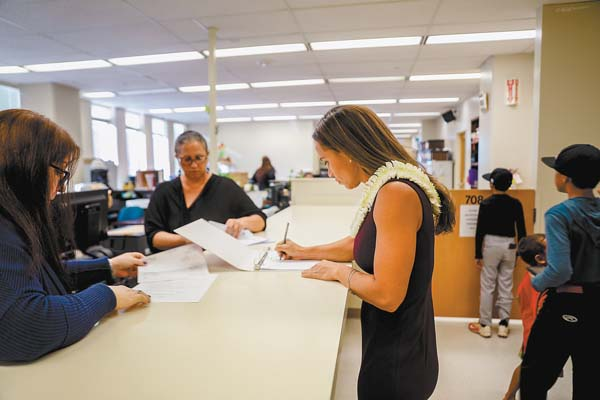 Tiare Lawrence is shown pulling nomination papers Tuesday to challenge Kyle Yamashita for the 12th House District seat.